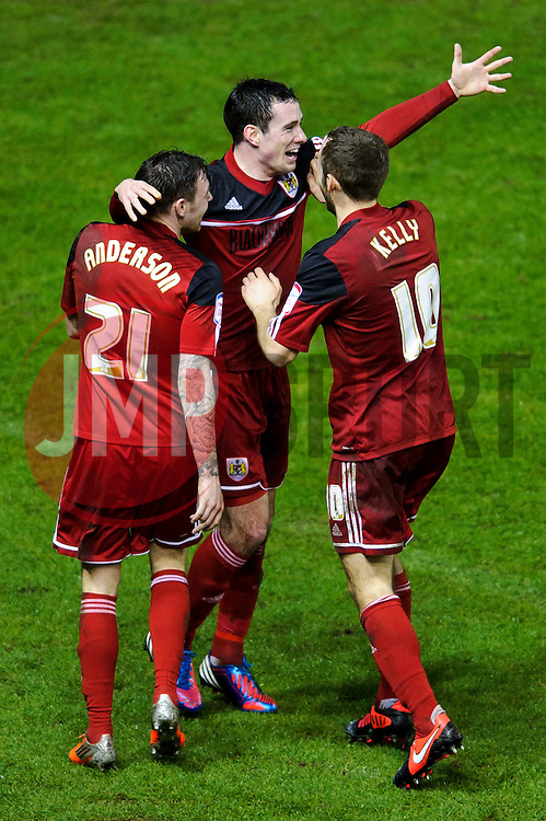 Bristol City Defender Greg Cunningham (IRL) celebrates with Midfielder Paul Anderson (ENG) and Midfielder Cole Skuse (ENG) after scoring a goal during the first half of the match - Photo mandatory by-line: Rogan Thomson/JMP - Tel: Mobile: 07966 386802 29/01/2013 - SPORT - FOOTBALL - Ashton Gate - Bristol. Bristol City v Watford - npower Championship.