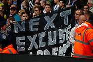 Newcastle United fans hold up a banner that reads 'NEXT EXCUSE PARDEW?' during the Barclays Premier League match at the Emirates Stadium, London<br /> Picture by David Horn/Focus Images Ltd +44 7545 970036<br /> 28/04/2014