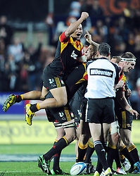 Chiefs Sona Taumalolo jumps on the back of a team mate as referee Craig Joubert blows the final whistle to win over the Crusaders in the Super 15 Rugby semi final match, Waikato Stadium, New Zealand, Friday, July 27, 2012. Credit:SNPA / Ross Setford