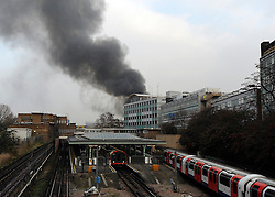 © Licensed to London News Pictures. 31/01/2012, London, UK. Tube services were disrupted. A huge fire, thought to be in an old dairy building containing small business is causing road and tube closures in Wood Lane, West London today 31 January 2012.  A large number of Fire Brigade and London Ambulance are in attendance. Photo credit : Stephen Simpson/LNP