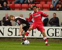 Photo: Leigh Quinnell.<br /> Swindon Town v Grimsby Town. Coca Cola League 2. 14/10/2006. Swindons Curtis Weston battles with Grimsbys Ricky Ravenhill.