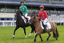 Frankie Dettori and his son Rocco on the course during a media day at Ascot Racecourse, Esher.