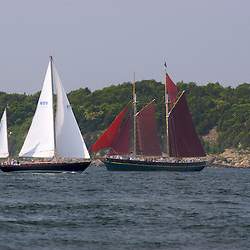 A classic sailing yachts cruising along the New England coast.
