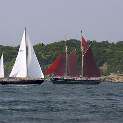 A classic sailing yachts cruising along the New England coast.