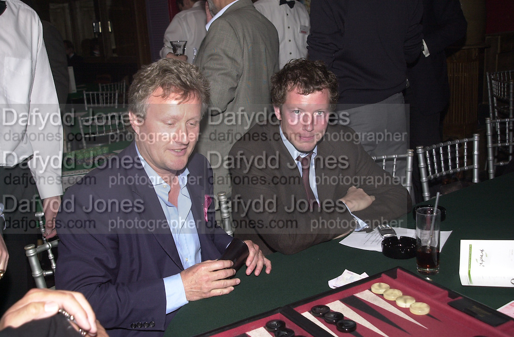 Sebastian taylor and Nat Rothschild. Referendum party poker evening. LEquipe Anglais. Duke St. 20 May 2002. © Copyright Photograph by Dafydd Jones 66 Stockwell Park Rd. London SW9 0DA Tel 020 7733 0108 www.dafjones.com