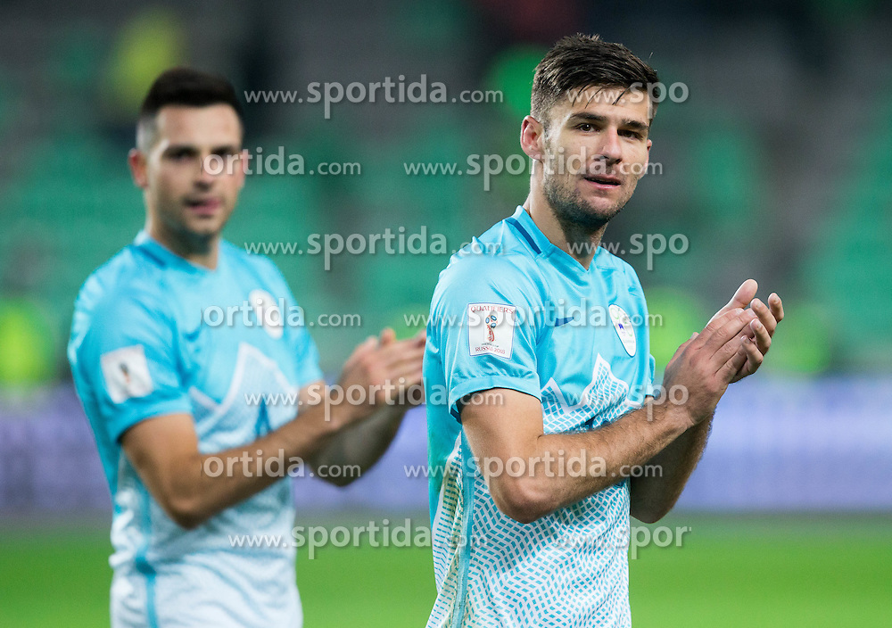 Miral Samardzic of Slovenia and Rok Kronaveter of Slovenia celebrate after the football match between National teams of Slovenia and England in Round #3 of FIFA World Cup Russia 2018 Qualifier Group F, on October 11, 2016 in SRC Stozice, Ljubljana, Slovenia. Photo by Vid Ponikvar / Sportida