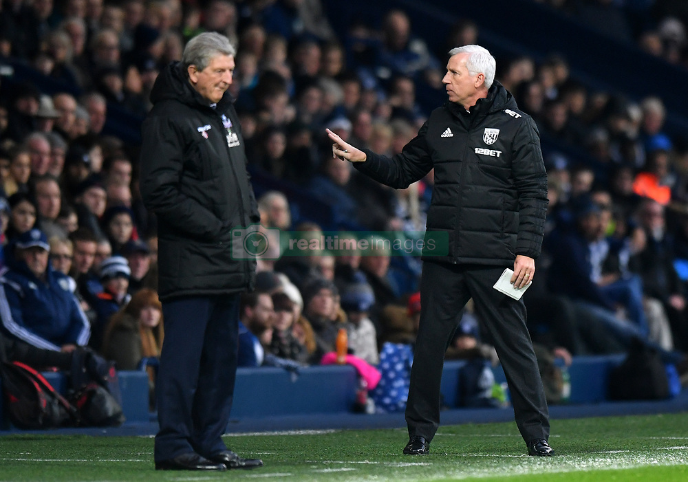 """West Bromwich Albion manager Alan Pardew (right) and Crystal Palace manager Roy Hodgson during the Premier League match at The Hawthorns, West Bromwich. PRESS ASSOCIATION Photo Picture date: Saturday December 2, 2017. See PA story SOCCER WBA. Photo credit should read: Anthony Devlin/PA Wire. RESTRICTIONS: EDITORIAL USE ONLY No use with unauthorised audio, video, data, fixture lists, club/league logos or """"live"""" services. Online in-match use limited to 75 images, no video emulation. No use in betting, games or single club/league/player publications."""
