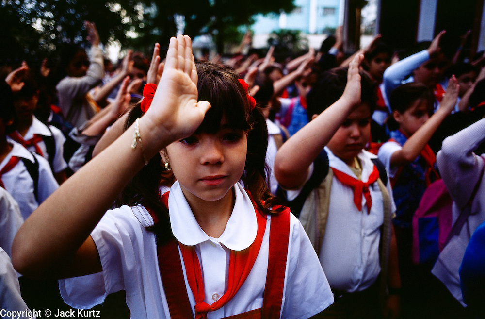 HAVANA, CUBA: A child salutes during an assembly before school in the Vedado neighborhood of Havana, Cuba, march 2000.   PHOTO BY  JACK KURTZ       EDUCATION    CHILDREN  PATRIOTISM