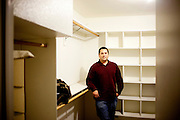 Derek Figg stands in the empty closet of his Tempe, Arizona home December 15, 2009. He stopped making mortgage payments in September. Mr. Figg bought the home in September 2007 and is moving out Sunday. CREDIT: Kendrick Brinson/Luceo Images for The Wall Street Journal