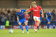 Ian Henderson and goalscorer Brad Potts during the EFL Sky Bet League 1 match between Rochdale and Barnsley at Spotland, Rochdale, England on 21 August 2018.