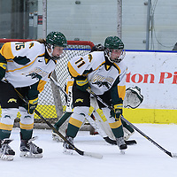 1st year forward Sam Geekie (15) and 4th year defender Jolene Kirkpatrick (11) of the Regina Cougars await the puck drop during the Women's Hockey Homeopener on October 7 at Co-operators arena. Credit: Arthur Ward/Arthur Images
