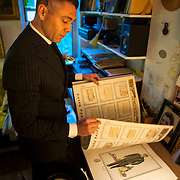 May 2, 2012 - Brooklyn, NY : Musician and composer Michael Arenella leafs through a book of vintage menswear in his apartment on Wednesday evening. CREDIT: Karsten Moran for The New York Times