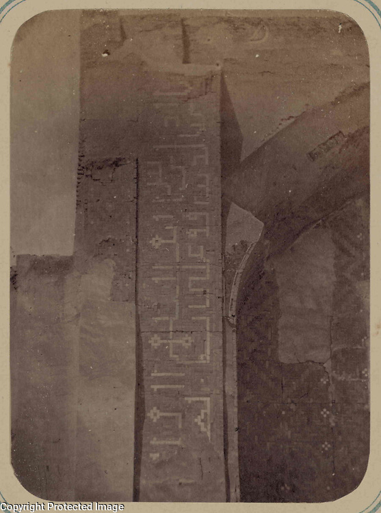 1868<br /> This photograph of the Nadir Divan-Begi Madrasah in Samarkand (Uzbekistan) is from the archeological part of Turkestan Album. The six-volume photographic survey was produced in 1871-72 under the patronage of General Konstantin P. von Kaufman, the first governor-general (1867-82) of Turkestan, as the Russian Empire&rsquo;s Central Asian territories were called. The album devotes special attention to Samarkand&rsquo;s Islamic architectural heritage. Located next to the Khodzha Akhrar shrine, this madrasah (religious school) was completed in 1631 by Nadir Divan-Begi, vizier and uncle of the Bukharan ruler Imam-Quli Khan. The madrasah was planned as a rectangular courtyard enclosed by a one-story cloister for scholars. This view shows the left side of the iwan (vaulted hall, walled on three sides, with one end open) arch in the middle of the north side of the cloistered courtyard. Although severely damaged, the outer surface of the iwan facade displays remnants of vertical bands of ceramic tiles in geometric patterns. Adjacent to the arch is an inscription band with stylized block Kufic letters. Above the iwan arch are fragments of faience mosaics with botanical figures. The larger surface within the arch niche is devoted to a geometric tile design whose intersecting lines create forms such as eight-pointed stars. The space within the lines is filled with intricate polychrome ceramic patterns.