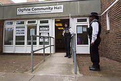© Licensed to London News Pictures. 22/05/2014. London, UK. Police officers stand outside a polling station at the Ogilvie Community Hall in Shadwell, East London on 22 May 2014.  All polling stations in Tower Hamlets today have a police presence to protect voters from any intimidation. Photo credit : Vickie Flores/LNP