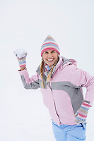 Woman throwing snowball portrait