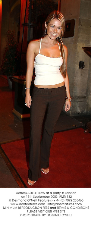Actress ADELE SILVA at a party in London on 18th September 2003.PMR 132