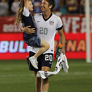 Abby Wambach, USA, is congratulated by Rylie Cate Rampone, daughter of team mate Christie Rampone at the end of the match after becoming the greatest goal scorer in international soccer. Wambach scored four goals during the U.S. Women's 5-0 victory over Korea Republic, friendly soccer match. The four goals brings her tally to 160 goals which eclipsed Mia Hamm's all-time goal record of 158 goals.  Red Bull Arena, Harrison, New Jersey. USA. 20th June 2013. Photo Tim Clayton