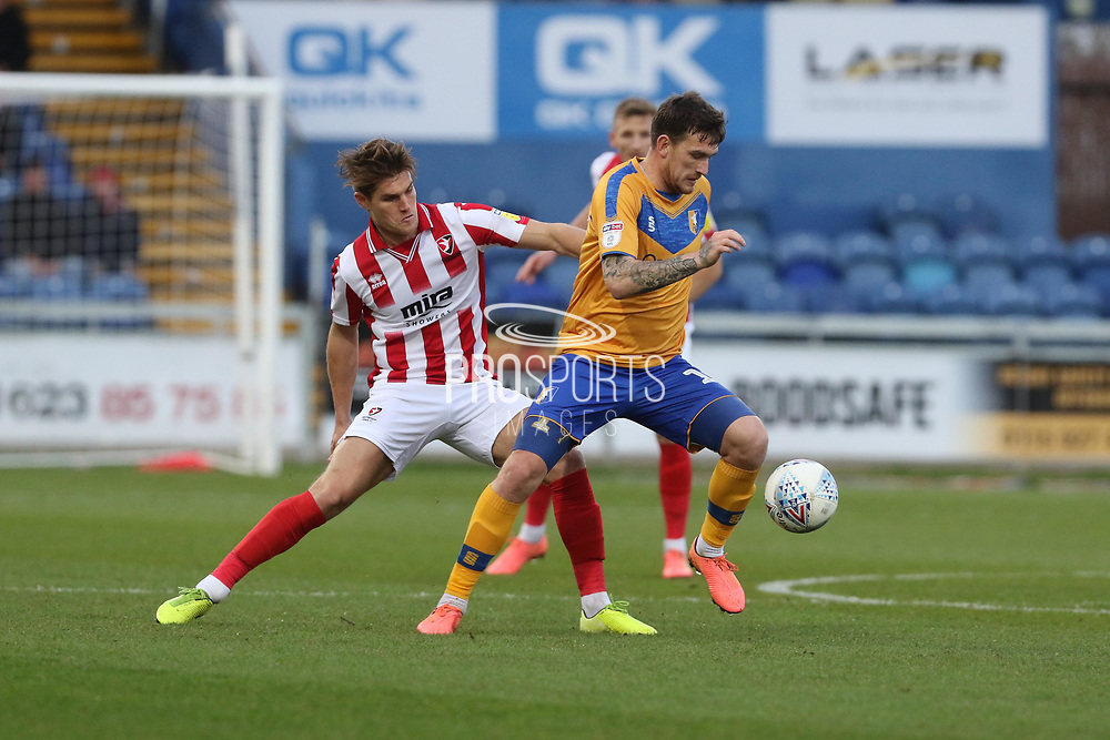 Charlie Raglan and Andy Cook  during the EFL Sky Bet League 2 match between Mansfield Town and Cheltenham Town at the One Call Stadium, Mansfield, England on 7 December 2019.