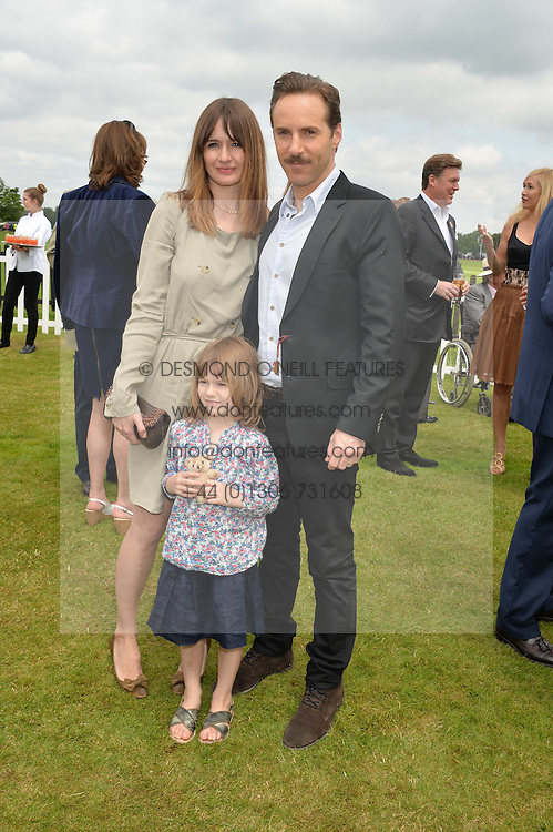 ALESSANDRO NIVOLA and EMILY MORTIMER with their daughter MARY ROSE NIVOLA at the Cartier Queen's Cup Polo final at Guard's Polo Club, Smiths Lawn, Windsor Great Park, Egham, Surrey on 14th June 2015