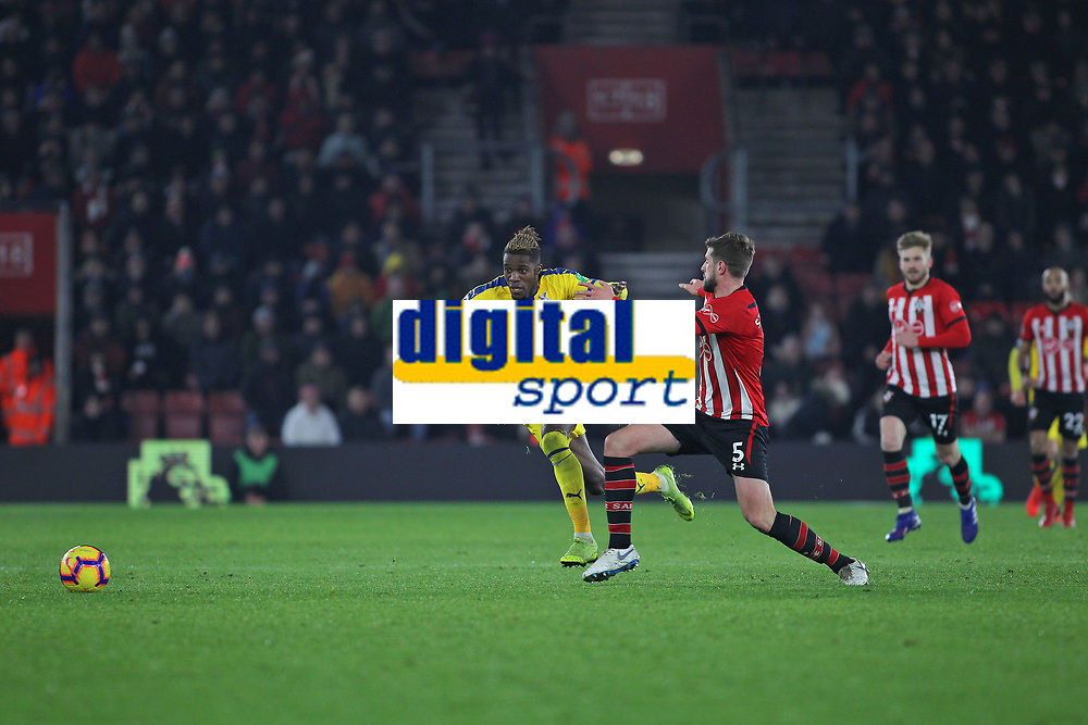 Football - 2018 / 2019 Premier League - Southampton vs. Crystal Palace<br /> <br /> Southampton's Jack Stephens steps across and tries fouls Wilfried Zaha of Crystal Palace during the Premier League match at St Mary's Stadium Southampton <br /> <br /> COLORSPORT/SHAUN BOGGUST