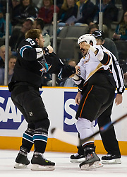 January 21, 2010; San Jose, CA, USA; San Jose Sharks left wing Ryane Clowe (29) fights with Anaheim Ducks right wing George Parros (16) during the first period at HP Pavilion. San Jose defeated Anaheim 3-1. Mandatory Credit: Jason O. Watson / US PRESSWIRE