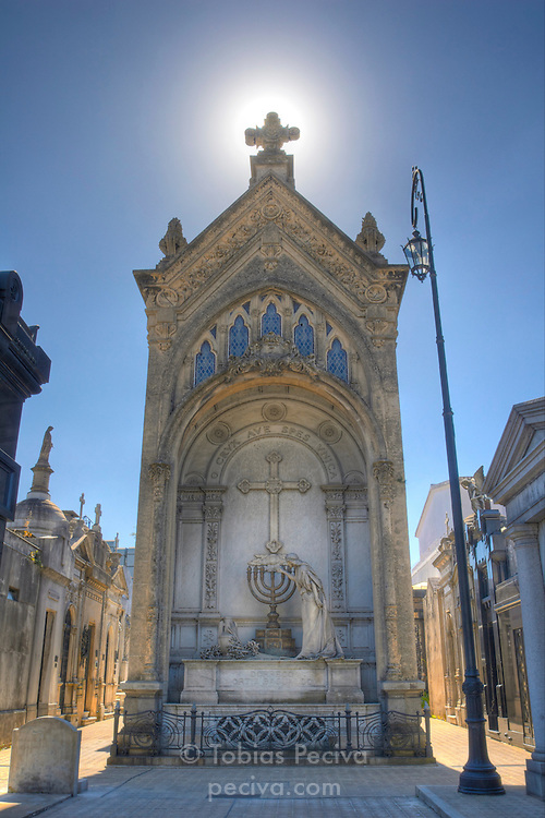 A large, backlit tomb in the Recoleta necropolis (Cementerio de la Recoleta), Buenos Aires.