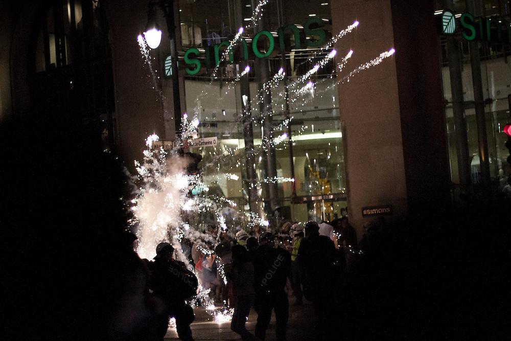 Firework explodes above heads of riot police, F1 weekend. Quebec Spring / Printemps Érable.