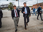 20 MAY 2019 - DAVENPORT, IOWA: BETO O'ROURKE, right, and KYLE CARTER, from the Chamber of Commerce, look at flood damage in Davenport. O'Rourke, running to be the 2020 Democratic nominee for the US Presidency, has made climate change a central part of his campaign. He toured flood damage in Davenport Monday. The Mississippi River flooded through downtown Davenport on April 30 and much of downtown is still recovering from the flood.     PHOTO BY JACK KURTZ