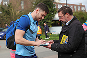 AFC Wimbledon goalkeeper Joe Day (21) signing autographs during the EFL Sky Bet League 1 match between AFC Wimbledon and Bolton Wanderers at the Cherry Red Records Stadium, Kingston, England on 7 March 2020.