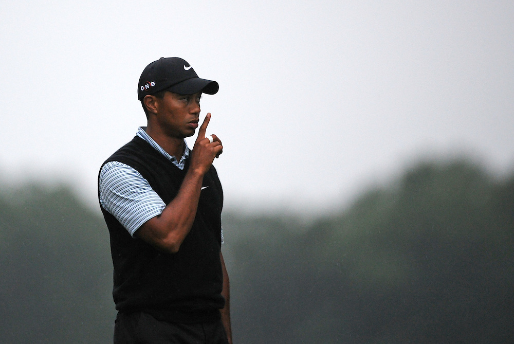 Tiger Woods of the US quiets a shouting fan on the 10th tee during the third round of the 109th US Open Championship on the Bethpage Black Course in Farmingdale, New York, USA, 20 June 2009.