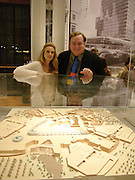 Emma Bell and Eric Kuhne. Behind the model of the Bluewater shopping centre which Eric Kuhne designed. V & A and Riba open Architecture Gallery and study rooms. V. & A. South Kensington, London. 16 November 2004. ONE TIME USE ONLY - DO NOT ARCHIVE  © Copyright Photograph by Dafydd Jones 66 Stockwell Park Rd. London SW9 0DA Tel 020 7733 0108 www.dafjones.com