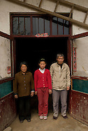 Zhang Ya'nan,12 whose parents work on the coast is an abandoned child or left behind -«  liushou ertong  » in Chinese - with her grandmother Yu Enlan, 65 and grandfather Zhang Xinzhi,68 in their home in Balizhuang village in Henan near Kaifeng. March 23rd 2008. ©Lionel DERIMAIS/2008 ©Lionel DERIMAIS/2008