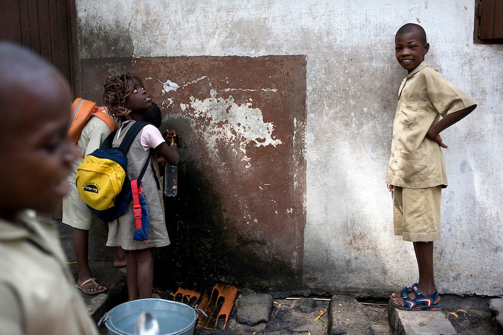 February 2008 - students at the  School for the Blind, drinking at the water-spring  in Cotonou, Benin. The School takes 80 blind students surrounding villages and at no cost to their families teaches them geography, science, math and a work for the future. Though the school belongs to the state, it receives considerable funding from ONG.