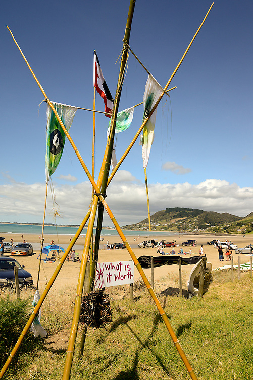 Placards and protesters at a concert at Shipwreck Bay, Ahipara, protesting at Norwegian firm Statoil's deep sea seismic testing off Northland's west coast, Northland, New Zealand, December 06, 2014. Credit:SNPA / Malcolm Pullman