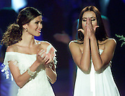 Miss Panama, Justine Pasek (L) looks on as Miss Russia Oxana Fedorova reacts as she wins the 2002 Miss Universe crown in San Juan, Puerto Rico, May 29, 2002. Fedorova, 24, is the first contestant from Russia to win the competition. REUTERS/Colin Braley