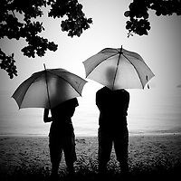 Couple with parasols on Thai Beach