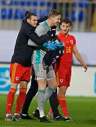 BAKU, AZERBAIJAN - Saturday, November 16, 2019: Wales' captain Gareth Bale (L) celebrates with goalkeeper Wayne Hennessey (C) after the UEFA Euro 2020 Qualifying Group E match between Azerbaijan and Wales at the Bakcell Arena. Wales won 2-0. (Pic by David Rawcliffe/Propaganda)