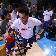 Delaware 87ers Forward Drew Gordon (32) celebrate as he is introduced to the home crowd prior to a NBA D-league regular season basketball game between the Delaware 87ers and the Grand Rapids Drive (Detroit Pistons) Saturday, Apr. 04, 2015 at The Bob Carpenter Sports Convocation Center in Newark, DEL.