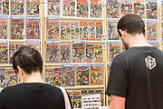 UNITED KINGDOM, London: 27-28 May 2017 Visitors look at a selection of comic books at a stall.<br /> The comic convention, which will be visited by tens of thousands of comic book and cosplay fans, is being held at London's ExCel this weekend. Rick Findler / Story Picture Agency
