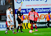 Exeter City's Joel Grant is yellow carded during the The FA Cup match between Exeter City and Port Vale at St James' Park, Exeter, England on 6 December 2015. Photo by Graham Hunt.