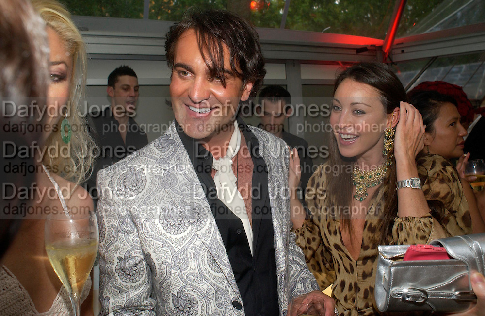 Martin Laurence-Bollard and Tamara Mellon. Glamour Women Of The Year Awards 2005, Berkeley Square, London.  June 7 2005. ONE TIME USE ONLY - DO NOT ARCHIVE  © Copyright Photograph by Dafydd Jones 66 Stockwell Park Rd. London SW9 0DA Tel 020 7733 0108 www.dafjones.com