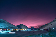 I wouldn't be exaggerating if I said that I got reeeeeally lucky to capture this image in 2015 in Longyearbyen. The pink glow was caused by the sunlight being reflected by stratospheric clouds. The position of the clouds between Svalbard and the Scandinavian mainland is the main cause of the red light rays.Although similar red skies were seen on the Archipelago in 2014, the phenomenon has not otherwise occurred since the early 2000s.