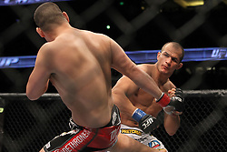 November 12, 2011; Anaheim, CA; USA; UFC Heavyweight Champion Cain Velasquez (red trunks) and Junior Dos Santos (white trunks) during their fight at UFC on FOX in Anaheim, CA.