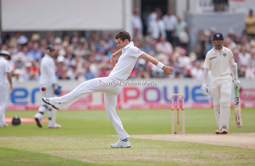 Bowler James Anderson kicks the ball as his team-mates go off for lunch during the second npower Test Match between England and India at Trent Bridge, Nottingham.  Photo: Graham Morris (Tel: +44(0)20 8969 4192 Email: sales@cricketpix.com) 30/07/11