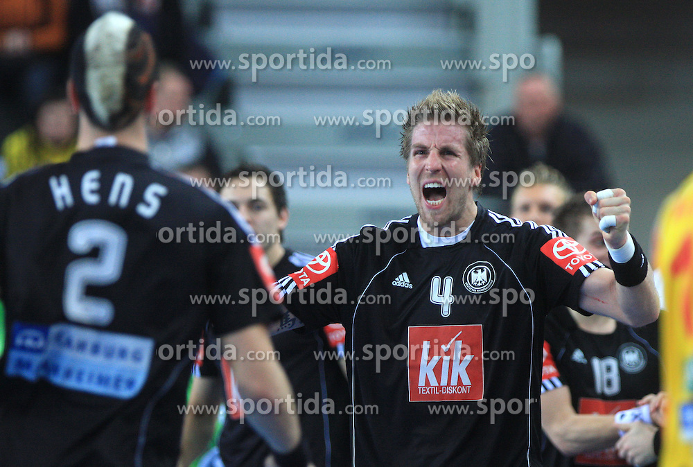 Oliver Roggisch (4) of Germany celebrates during 21st Men's World Handball Championship preliminary Group C match between FYR Macedonia and Germany, on January 21, 2009, in Arena Varazdin, Varazdin, Croatia. (Photo by Vid Ponikvar / Sportida)
