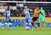 Brighton striker, Richie Towell (29) and Hull City midfielder Tom Huddlestone (8) during the The FA Cup match between Hull City and Brighton and Hove Albion at the KC Stadium, Kingston upon Hull, England on 9 January 2016.