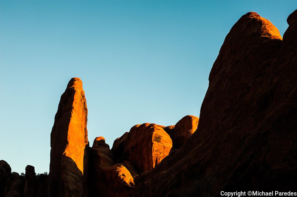 Desert rock formations flooded with sunrise at Arches National Park, Utah