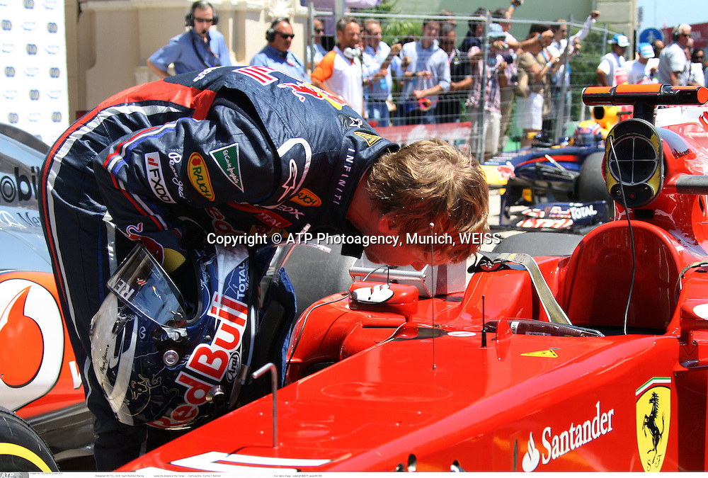 Sebastian VETTEL, GER, Team Red Bull Racing looks into details in the Ferrari, his future race car as of 2015  -<br />  - Formula One - Formel 1 -   Fee liable image - copyright &copy; ATP Jacky WEISS