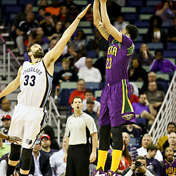 Feb 1, 2016; New Orleans, LA, USA; New Orleans Pelicans forward Anthony Davis (23) shoots over Memphis Grizzlies center Marc Gasol (33) during the first quarter of a game at the Smoothie King Center. Mandatory Credit: Derick E. Hingle-USA TODAY Sports