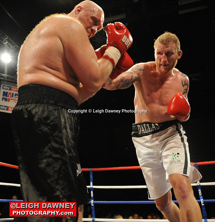 Tom Dallas (white shorts) defeats Daniil Peretyatko at the Brentwood Centre on 25th June 2010.Frank Maloney Promotions. Photo credit: © Leigh Dawney